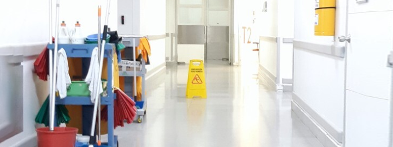 A hospital corridor with cleaning equipment